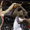 Charlotte Bobcats\' Michael Kidd-Gilchrist (14) has his shot blocked by Milwaukee Bucks\' Mike Dunleavy (17) and Ekpe Udoh (13) during the first half of an NBA basketball game in Charlotte, N.C., Monday, Nov. 19, 2012. (AP Photo/Chuck Burton)