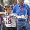 Steve Loveland watches as ten year old Caden Frazier uses a bow and arrow during school day of the Oklahoma Wildlife Expo at the Lazy E Arena and Ranch in Guthrie, OK, Friday, September 28, 2012, By Paul Hellstern, The Oklahoman