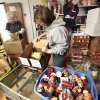 Photo -  Memorial Baptist Church members Mary Miller Wenzel, Kathy Behlke, center, and Christine Popp, of Fond du Lac,Wis., sort some supplies in a McLoud food bank.  David McDaniel - The Oklahoman