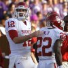 Oklahoma Sooners\' Landry Jones (12) pats Roy Finch (22) on the back after Finch scored a touchdown during the college football game between the University of Oklahoma Sooners (OU) and the Kansas State University Wildcats (KSU) at Bill Snyder Family Stadium on Sunday, Oct. 30, 2011. in Manhattan, Kan. Photo by Chris Landsberger, The Oklahoman ORG XMIT: KOD