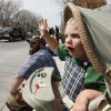 Two year old Seamus Carter waves from his stroller during the annual Saint Patrick\'s Day Parade in downtown Oklahoma City, OK, Saturday, March 16, 2013, By Paul Hellstern, The Oklahoman