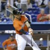 Photo - Miami Marlins' Giancarlo Stanton hits a double during the fourth inning of a baseball game against the New York Mets, Monday, July 29, 2013 in Miami. The Mets defeated the Marlins 6-5. (AP Photo/Wilfredo Lee)