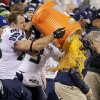 Seattle Seahawks\' Zach Miller dumps Gatorade on Seattle Seahawks head coach Pete Carroll during the second half of the NFL Super Bowl XLVIII football game Sunday, Feb. 2, 2014, in East Rutherford, N.J. The Seahawks won 43-8. (AP Photo/Gregory Bull)