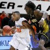 OSU\'s Byron Eaton dribbles past Missouri\'s DeMarre during the Big 12 college basketball game between Oklahoma State and Missouri at Gallagher-Iba Arena in Stillwater, Okla., Wednesday, Jan. 21, 2009. PHOTO BY BRYAN TERRY, THE OKLAHOMAN