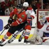 Photo - Chicago Blackhawks' Bryan Bickell (29) controls the puck against  Montreal Canadiens' P.K. Subban (76) as goalie Peter Budaj (30) looks on during the second period of an NHL hockey game in Chicago, Wednesday, April 9, 2014. (AP Photo/Nam Y. Huh)