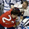 Florida Panthers\' George Parros, left, and Toronto Maple Leafs\' Colton Orr fight during the first period of an NHL hockey game in Sunrise, Fla., Monday, Feb. 18, 2013. (AP Photo/J Pat Carter)