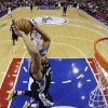 Memphis Grizzlies\' Jerryd Bayless goes up for a dunk during the first half of an NBA basketball game against the Philadelphia 76ers, Monday, Jan. 28, 2013, in Philadelphia. (AP Photo/Matt Slocum)