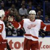 Detroit Red Wings\' Jakub Kindl, of the Czech Republic, is congratulated by Drew Miller, left, after scoring during the first period of an NHL hockey game against the St. Louis Blues on Thursday, Feb. 7, 2013, in St. Louis. (AP Photo/Jeff Roberson)