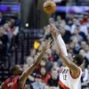 Portland Trail Blazers forward LaMarcus Aldridge, right, shoots over Miami Heat center Chris Bosh during the first quarter of an NBA basketball game in Portland, Ore., Thursday, Jan. 10, 2013. (AP Photo/Don Ryan)