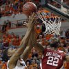 Oklahoma State\'s Le\'Bryan Nash (2) shoots as Oklahoma\'s Amath M\'Baye (22) defends during the Bedlam men\'s college basketball game between the Oklahoma State University Cowboys and the University of Oklahoma Sooners at Gallagher-Iba Arena in Stillwater, Okla., Saturday, Feb. 16, 2013. Photo by Sarah Phipps, The Oklahoman