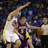 Photo - Los Angeles Lakers' Steve Blake (5) drives the ball against Golden State Warriors' Klay Thompson during the first half of an NBA basketball game on Wednesday, Oct. 30, 2013, in Oakland, Calif. (AP Photo/Ben Margot)