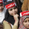 Egyptian pro-military supporters wear scarves with Arabic reading,