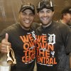Photo - Detroit Tigers' Brayan Pena, left, and Alex Avila smile as they celebrate after the Tigers won the AL Central title with a 1-0 win over the Minnesota Twins in a baseball game, Wednesday, Sept. 25, 2013, in Minneapolis. (AP Photo/Jim Mone)