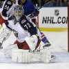 Photo - Columbus Blue Jackets goalie Sergei Bobrovsky (72), of Russia, watches a puck shot past the goal during the second period of an NHL hockey game against the New York Rangers Monday, Jan. 6, 2014, in New York.  (AP Photo/Frank Franklin II)