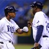 Photo - Tampa Bay Rays' Tim Beckham, left, celebrates with Rays first base coach George Hendrick after hitting a single during the eighth inning of a baseball game against the Texas Rangers, Thursday, Sept. 19, 2013, in St. Petersburg, Fla. (AP Photo/Brian Blanco)