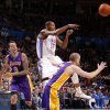 Oklahoma City\'s Kevin Durant (35) passes the ball from between Los Angeles\' Matt Barnes (9) and Steve Blake (5) during an NBA basketball game between the Oklahoma City Thunder and the Los Angeles Lakers at Chesapeake Energy Arena in Oklahoma City, Thursday, Feb. 23, 2012. Photo by Bryan Terry, The Oklahoman