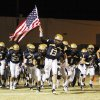 Cooper Cloud (13) leads the Heritage Hall Chargers on the field before the high school football playoff game between Bridge Creek and Heritage Hall at Heritage Hall School in Oklahoma City, Friday, Nov. 19, 2010. Photo by Nate Billings, The Oklahoman