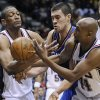 New Jersey Nets\' Tony Battie, left, and Trenton Hassell, right, battle for control of the ball with Oklahoma City Thunder forward Nick Collison during the fourth quarter of an NBA basketball game Monday, Dec. 28, 2009, in East Rutherford, N.J. The Thunder beat the Nets 105-89. (AP Photo/Bill Kostroun) ORG XMIT: ERA108