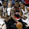Portland Trail Blazers\' Wesley Matthews (2) looks for an opening against Dallas Mavericks\' O.J. Mayo, left, and Brandan Wright (34) during the second half of an NBA basketball game Monday, Nov. 5, 2012, in Dallas. Matthews had 20 points in the 114-91 loss to the Mavericks. (AP Photo/Tony Gutierrez)