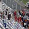 A tire from a car lies in the seats after a crash at the conclusion of the NASCAR Nationwide Series auto race Saturday, Feb. 23, 2013, at Daytona International Speedway in Daytona Beach, Fla. Kyle Larson\'s car hit the catch fence during the wreck. (AP Photo/David Graham)