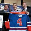 Edmonton Oilers general manager Steve Tambellini, left, holds up a jersey with draft pick Taylor Hall, center, and Kevin Lowe, the NHL team\'s president of hockey operations, in Edmonton, Alberta, on Wednesday, Sept. 8, 2010. Lowe, the Oilers\' first-ever draft pick and only player to wear the number since Edmonton entered the NHL in 1979, passed his No. 4 to Hall, the centerpiece of a full-scale rebuild in Edmonton and the franchise\'s first No. 1 overall draft pick. (AP Photo/The Canadian Press, John Ulan) ORG XMIT: JCU102