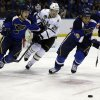 St. Louis Blues\' Ryan Reaves, right, and Vladimir Sobotka, left, of the Czech Republic, and Dallas Stars\' Matt Fraser, center, chase after a loose puck during the third period of an NHL hockey game on Friday, April 19, 2013, in St. Louis. The Blues won 2-1. (AP Photo/Jeff Roberson)