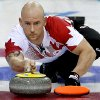 Photo - Canada's Ryan Fry delivers the rock during the men's curling match against the United States at the 2014 Winter Olympics, Sunday, Feb. 16, 2014, in Sochi, Russia. (AP Photo/Wong Maye-E)