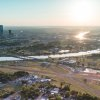 Photo -  The former Downtown Airpark and most of the property shown to the east will be redeveloped as Wheeler, a new urbanist neighborhood that will tie into the Oklahoma River and downtown. Photo provided    Provided