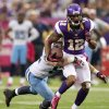 Photo -   Minnesota Vikings wide receiver Percy Harvin (12) breaks a tackle by Tennessee Titans linebacker Colin McCarthy, left, during the first half of an NFL football game on Sunday, Oct. 7, 2012, in Minneapolis. (AP Photo/Genevieve Ross)
