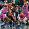 Photo - Pittsburg's Marquel Davis and Wake Forest's Chelsea Douglas battle for a loose ball during the third game of the ACC women's basketball tournament at the Greensboro Coliseum on Wednesday, March 5, 2014, in Greensboro, NC.  (AP Photo/News & Record, Jerry Woolford)