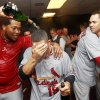 From left to right, St. Louis Cardinals\' Victor Marte, Jon Jay, Chris Carpenter and Carlos Beltran celebrate in the locker room after defeating the Atlanta Braves 6-3 in the National League wild card playoff baseball game on Friday, Oct. 5, 2012, in Atlanta. (AP Photo/John Bazemore)
