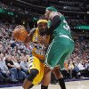 Denver Nuggets guard Ty Lawson, left, is fouled while driving to the basket by Boston Celtics forward Paul Pierce in the fourth quarter of the Nuggets\' 97-90 victory in an NBA basketball game in Denver on Tuesday, Feb. 19, 2013. (AP Photo/David Zalubowski)