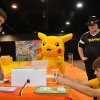 Photo - Oklahoma State University student Jonathon Giles, left, competes in May at a regional qualifier tournament in Dallas for a chance to compete in the 2010 Pokemon Video Game Championships. PHOTO PROVIDED      ORG XMIT: 1006241604020808