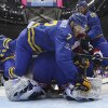 Photo - Sweden defenseman Henrik Tallinder trips over Sweden goaltender Henrik Lundqvist in the first period of a men's ice hockey game against the Czech Republic at the 2014 Winter Olympics, Wednesday, Feb. 12, 2014, in Sochi, Russia. (AP Photo/Bruce Bennett, Pool)