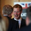 Photo - Britain's Prince Harry attends a reception at Club House of Sanctuary Golf Course in Sedalia, Colo., Friday, May 10, 2013. The visit is part of a weeklong visit to the United States that started in Washington and will also include trips to parts of New Jersey damaged by Superstorm Sandy. (AP Photo/The Denver Post, Hyoung Chang, Pool)