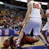 Oklahoma\'s Sharane Campbell (24) dives for the ball under Iowa State\'s Anna Prins (55) during the Big 12 tournament women\'s college basketball game between the University of Oklahoma and Iowa State University at American Airlines Arena in Dallas, Sunday, March 10, 2012. Photo by Bryan Terry, The Oklahoman
