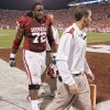 Oklahoma\'s Duke Robinson (72) walks off the field with trainers during the first quarter of the college football game between the University of Oklahoma Sooners (OU) and the University of Nebraska Huskers (NU) at the Gaylord Family-Oklahoma Memorial Stadium, on Saturday, Nov. 1, 2008, in Norman, Okla. BY NATE BILLINGS, THE OKLAHOMAN