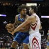 New Orleans Hornets\' Robin Lopez, left, faces Houston Rockets\' Omer Asik, right, during the first half of an NBA basketball game, Wednesday, Nov. 14, 2012, in Houston. (AP Photo/Pat Sullivan)