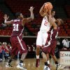 OU\'s Cameron Clark (21) tries to pass the ball between Mark Robertson (31) and Kevin White (3) of Maryland Eastern Shore during the men\'s college basketball game between Maryland Eastern Shore and Oklahoma at Lloyd Noble Center in Norman, Okla., Monday, January 3, 2011. OU won, 73-49. Photo by Nate Billings, The Oklahoman