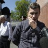 Photo - Ruslan Tsarni, right, uncle of killed Boston Marathon bombing suspect Tamerlan Tsarnaev, prepares to speak with reporters in front of the Graham, Putnam, and Mahoney Funeral Parlors, in Worcester, Mass., as funeral director and owner Peter Stefan, left, stands nearby, Sunday, May 5, 2013. Stefan has pleaded for government officials to use their influence to convince a cemetery to bury Tsarnaev, but so far no state or federal authorities have stepped forward. (AP Photo/Steven Senne)