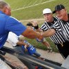Guthrie head coach Rafe Watkins talks with referee Jim Unruh, left, and umpire Don Schieber before a high school football game between Guthrie and Guymon at Jelsma Stadium in Guthrie, Okla., Friday, Sept. 21, 2012. Watkins has watched the last 8 games from the stands as he served a suspension dating back to last year. Photo by Nate Billings, The Oklahoman