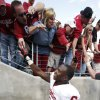 Oklahoma\'s Demontre Hurst is created by fans after the college football game where the University of Oklahoma Sooners (OU) defeated the Texas Christian University Horned Frogs (TCU) 24-17 at Amon G. Carter Stadium in Fort Worth, Texas, on Saturday, Dec. 1, 2012. Photo by Steve Sisney, The Oklahoman