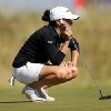 Photo - Mo Martin of the US lines up a shot on the 9th green during the second day of the Women's British Open golf championship on the Royal Birkdale Golf Club, Southport, England, Friday July 11, 2014. (AP Photo/Scott Heppell)