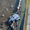 Photo - This aerial photo shows the scene where three freight trains collided near Amarillo, Texas on Wednesday, Sept. 25, 2013. An eastbound BNSF Railway train rear-ended a stopped train, derailing up to 30 cars and injuring four crewmembers including two critically. (AP Photo/The Amarillo Globe News, Michael Schumacher)