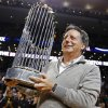 Photo - FILE - In this Nov. 1, 2013, file photo, Boston Red Sox Chairman Tom Werner holds the World Series trophy on the court before an NBA basketball game between the Boston Celtics and the Milwaukee Bucks in Boston. Baseball's 30 owners will meet in Baltimore this week to vote on Major League Baseball Commissioner Bud Selig's replacement. A seven-man committee whittled down an expansive list to three candidates: MLB Chief Operating Officer Rob Manfred, Boston Red Sox Chairman Tom Werner and MLB Executive Vice President of Business Tim Brosnan. (AP Photo/Michael Dwyer, file)