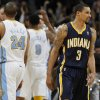 Indiana Pacers guard George Hill, front right, turns away as Denver Nuggets guard Andre Miller, front left, joins teammates as they congratulate Andre Iguodala after he hit the winning free throw in the fourth quarter of the Nuggets\' 102-101 victory in an NBA basketball game in Denver on Monday, Jan. 28, 2013. (AP Photo/David Zalubowski)