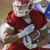 Photo - COLLEGE FOOTBALL: Trey Millard (33) carries the ball during spring football practice for the OU Sooners on the campus of the University of Oklahoma in Norman, Okla., Monday, March 5, 2012. Photo by Nate Billings, The Oklahoman