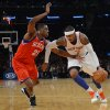 Photo -   New York Knicks' Carmelo Anthony, right, drives on the Philadelphia 76ers' Thaddeus Young in the first quarter of the NBA basketball game at Madison Square Garden in New York, Sunday, Nov. 4, 2012. (AP Photo/Henny Ray Abrams)