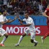 United States\' Julian Green, center, celebrates after scoring his side\'s first goal during the World Cup round of 16 soccer match between Belgium and the USA at the Arena Fonte Nova in Salvador, Brazil, Tuesday, July 1, 2014. (AP Photo/Matt Dunham)