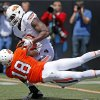 Oklahoma State\'s Deion Imade pulls the ball away from Blake Jackson for an incompletion during OSU\'s spring football game at Boone Pickens Stadium in Stillwater, Okla., Sat., April 20, 2013. Photo by Bryan Terry, The Oklahoman